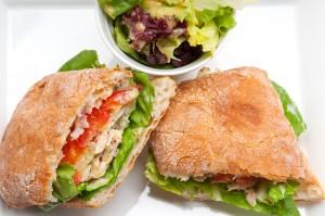 italian ciabatta panini sandwich with chicken and tomato